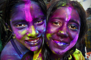"Two girls from the Hindu community, on the popular Hindu color festival known as ""Holi"" which takes place over two days in the later part of February or March. First day they use dry color known as ""Abir"" and second day use liquid color for celebration. Shakhari Bazar, Dhaka, Bangladesh. March 22, 2008."