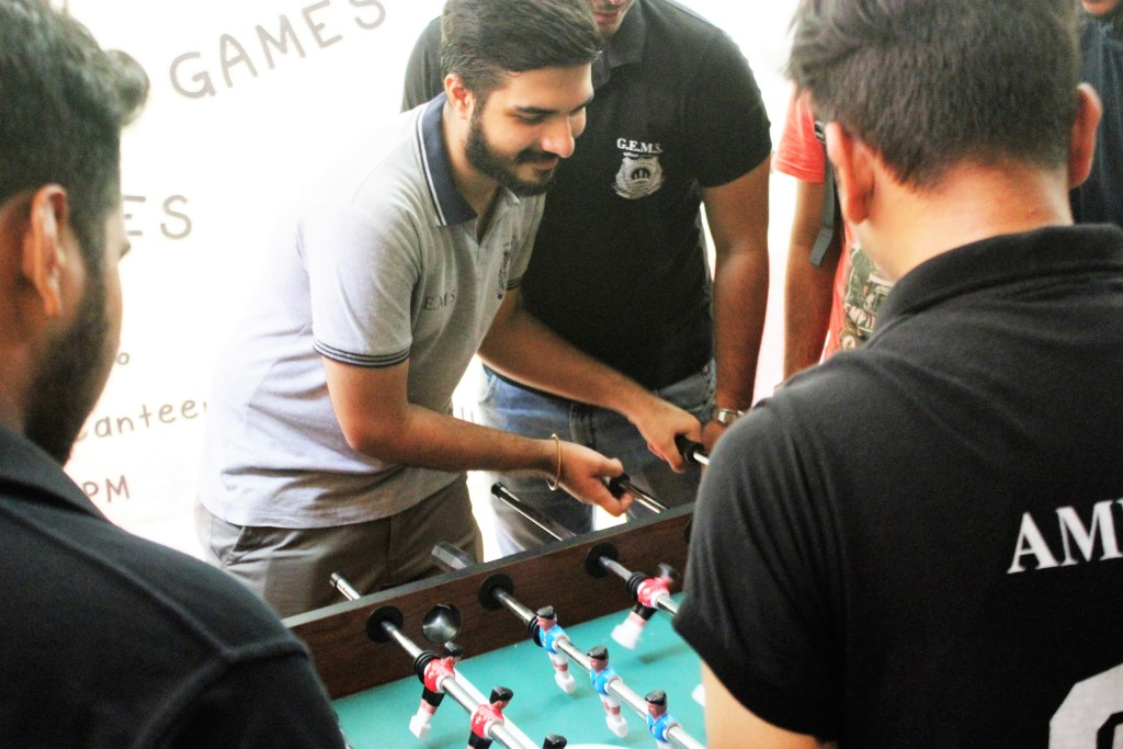Vinay Amarnani playing Foosball